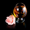 Glass with alcohol and rose. - PhotoDune Item for Sale