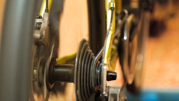 Man Training On Sport Machine In Fitness Club