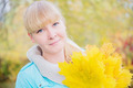 Blonde girl with yellow maple leaf - PhotoDune Item for Sale