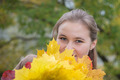Young girl with yellow maple leaf - PhotoDune Item for Sale