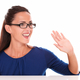 Friendly girl with glasses gesturing a greeting - PhotoDune Item for Sale