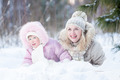 Happy family mother and daughter  playing with snow in winter outdoor - PhotoDune Item for Sale