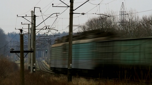 Freight Train Passes Railway Crossing Rapid