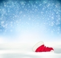 Blue Holiday Christmas background with santa hat, snow and snowflakes - PhotoDune Item for Sale