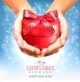 Holiday christmas background with hands holding gift box. - PhotoDune Item for Sale