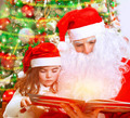 Reading fairytale with Santa Claus - PhotoDune Item for Sale