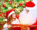 Reading magic book with Santa Claus - PhotoDune Item for Sale