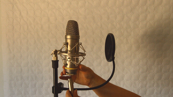 Woman Connects Studio Microphone