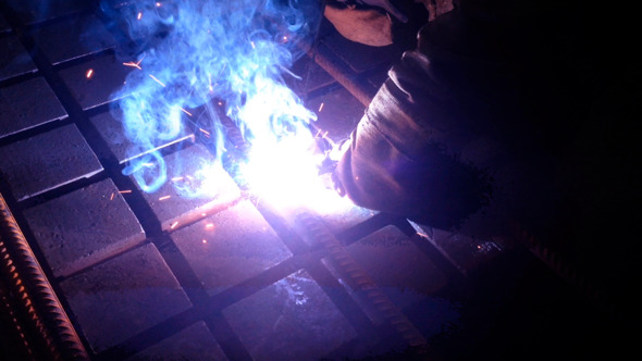 Worker Welding Armature With Electric Welder