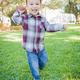 Cute Young Mixed Race Boy Playing Football Outside At The Park. - PhotoDune Item for Sale