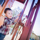 Cute Young Mixed Race Boy Having Fun Outside on Railroad Car. - PhotoDune Item for Sale