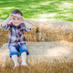 Cute Young Mixed Race Boy Having Fun on Hay Bale Outside. - PhotoDune Item for Sale