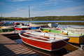 Floating Color Wooden Boats with Paddles in a Lake - PhotoDune Item for Sale
