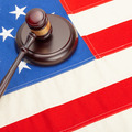 Wooden judge gavel and soundboard laying over US flag - court judgment concept - PhotoDune Item for Sale