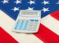 Calculator over USA flag - accounting concept - PhotoDune Item for Sale