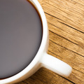Close up of coffee cup on wooden table - view from - PhotoDune Item for Sale
