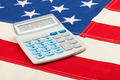 Neat calculator over USA flag - accounting concept - PhotoDune Item for Sale