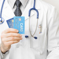 Doctor holding credit cards in his hand - health care concept - PhotoDune Item for Sale