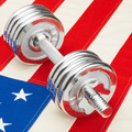 Metal dumbbells over US flag as symbol of healthy nation - healthy lifestyle concept - PhotoDune Item for Sale