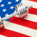 Metal dumbbells over USA flag as symbol of healthy nation - healthy lifestyle concept - PhotoDune Item for Sale