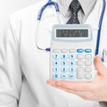 Doctor holdling in his hand calculator - medical aid concept - PhotoDune Item for Sale
