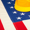 Construction helmet laying over US flag - construction industry concept - PhotoDune Item for Sale