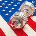 Metal dumbbell over US flag as symbol of healthy life style - healthy lifestyle concept - PhotoDune Item for Sale