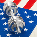Metal dumbbell over US flag as symbol of healthy nation - healthy lifestyle concept - PhotoDune Item for Sale