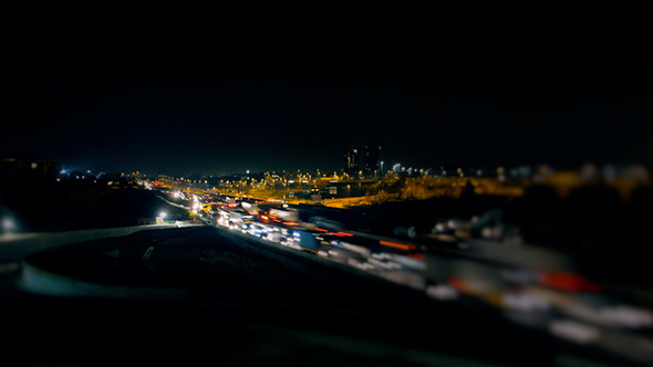 Busy City and Fast Traffic in the Night