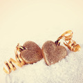 Two hearts with gold tapes on snow - PhotoDune Item for Sale