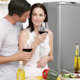 Couple Drinking Wine And Eating Salad In The Kitchen  - VideoHive Item for Sale