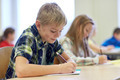 group of school kids writing test in classroom - PhotoDune Item for Sale