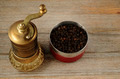 old oriental pepper mill and black pepper peas - PhotoDune Item for Sale