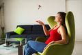 Woman home owner playing with keys of new house on sofa - PhotoDune Item for Sale