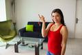 Portrait female home owner smiling holding keys new house - PhotoDune Item for Sale