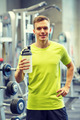 smiling man with protein shake bottle - PhotoDune Item for Sale