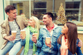 group of smiling friends with take away coffee - PhotoDune Item for Sale