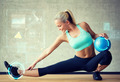 smiling woman with exercise ball in gym - PhotoDune Item for Sale