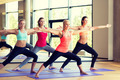 group of smiling women stretching in gym - PhotoDune Item for Sale