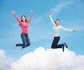smiling young women jumping in air - PhotoDune Item for Sale