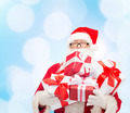 man in costume of santa claus with gift boxes - PhotoDune Item for Sale