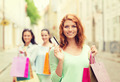 smiling teenage girls with shopping bags on street - PhotoDune Item for Sale