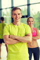 smiling man and woman in gym - PhotoDune Item for Sale