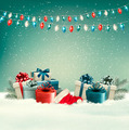 Winter christmas background with gifts and a garland.  - PhotoDune Item for Sale