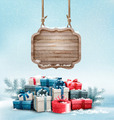 Christmas background with a retro wooden sign and gift boxes.  - PhotoDune Item for Sale