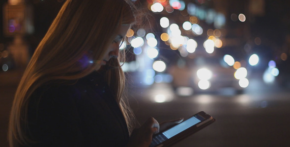 Girl Using Touchpad at Night