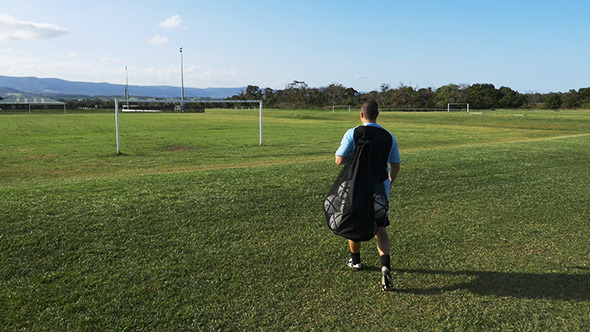 Football Soccer Player Walking to the Fields