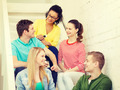 smiling students with smartphone having discussion - PhotoDune Item for Sale