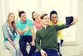 smiling students making picture with tablet pc - PhotoDune Item for Sale