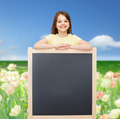 happy little girl with blank blackboard - PhotoDune Item for Sale
